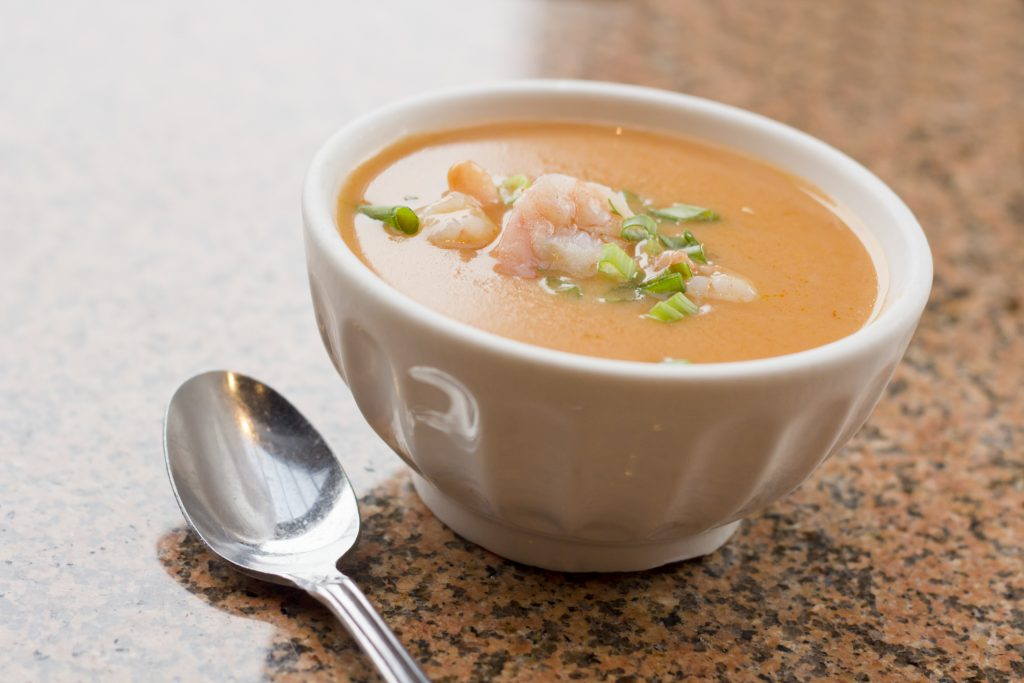 Fresh hot shrimp bisque with green onions at local restaurant